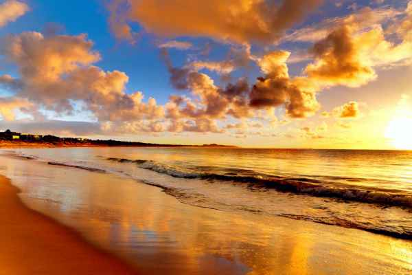 Carta da parati Onde dorate al tramonto